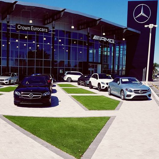 commercial artificial grass installation at a mercedes dealership